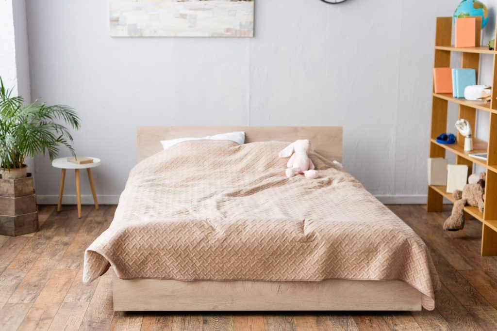 a modern bed with a bookshelf with a bed bug mattress cover
